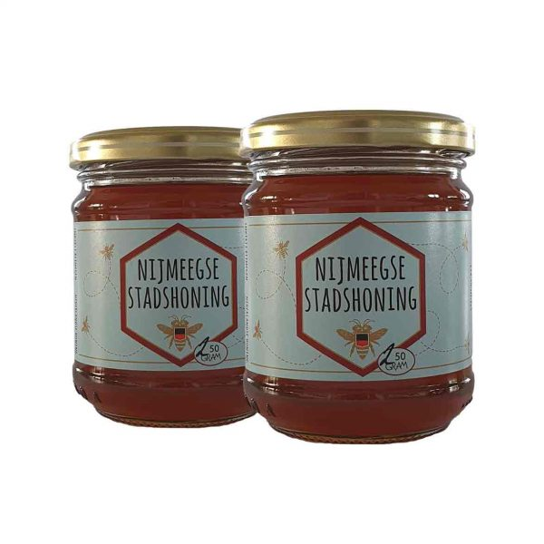 Foto van de potjes honing van 250 ml